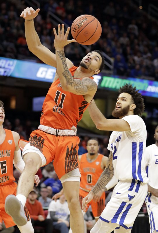 Bowling Green's Antwon Lillard (11) and Buffalo's Jeremy Harris (2) battle for a rebound during the first half of an NCAA college basketball championship game of the Mid-American Conference men's tournament, Saturday, March 16, 2019, in Cleveland. (AP Photo/Tony Dejak)
