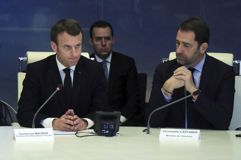 French President Emmanuel Macron, left, presides over an emergency crisis meeting with French Interior Minister Christophe Castaner, at the Interior Ministry in Paris , France, Saturday, March 16, 2019. (Philippe Petit-Tesson/Pool photo via AP)