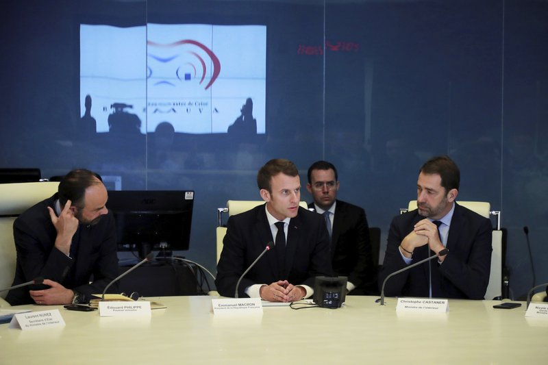 French President Emmanuel Macron, center, presides over an emergency crisis meeting with French Prime Minister Edouard Philippe, left, and French Interior Minister Christophe Castaner at the Interior Ministry in Paris , France, Saturday, March 16, 2019. (Philippe Petit-Tesson/Pool photo via AP)