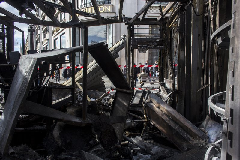 Inside view of the burned out remains of terrasse of the famed restaurant Le Fouquet's on the Champs Elysees the day after it was vandalized and set on fire during the 18th straight weekend of demonstrations by the yellow vests, in Paris, France, Sunday, March 17, 2019. (AP Photo/Rafael Yaghobzadeh)