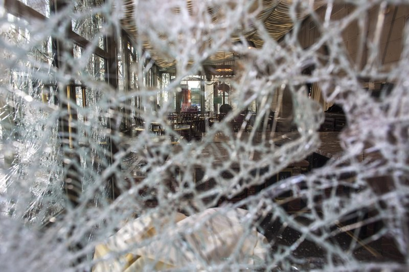 The inside view of the famed tea salon Laduree pictured through smashed windows the day after it was vandalized during the 18th straight weekend of demonstrations by the yellow vests, in Paris, France, Sunday, March 17, 2019. (AP Photo/Rafael Yaghobzadeh)