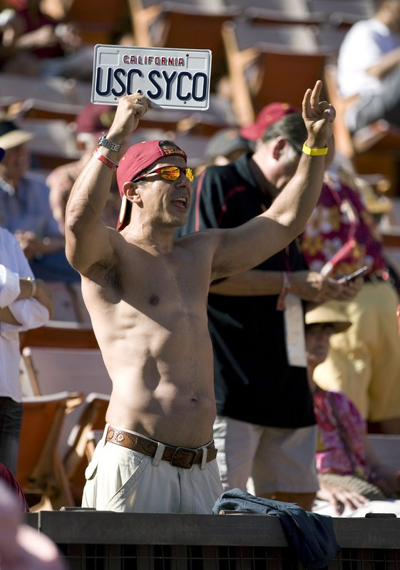 FILE - In this Sept. 2, 2010 file photo Roy Nwaisser, of Los Angeles, cheers during an NCAA college football game between the University of Southern California and Hawaii at Aloha Stadium in Honolulu. (AP Photo/Eugene Tanner,File)