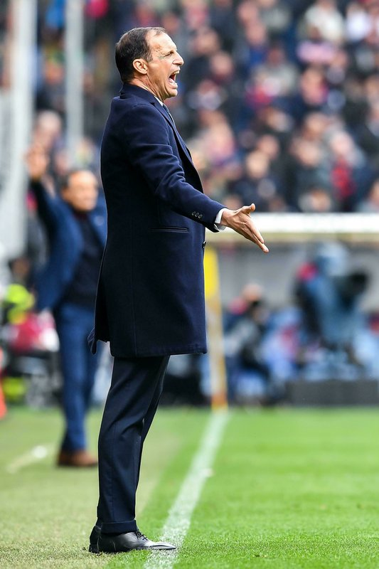 Juventus coach Massimiliano Allegri shouts directions to his players during a Serie A soccer match between Genoa and Juventus at Luigi Ferraris Stadium in Genoa, Italy, Sunday, March 17, 2019. (Simone Arveda/ANSA via AP)