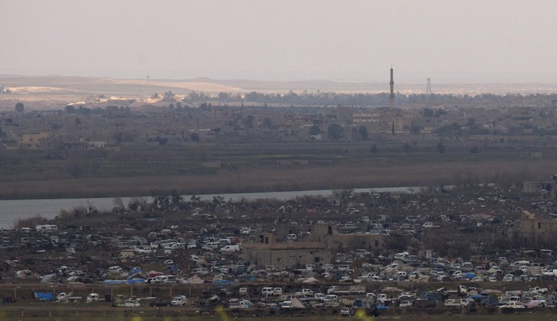 The Islamic State group's last pocket of territory in Baghouz, Syria, as seen from a distance on Sunday, March 17, 2019. (AP Photo/Maya Alleruzzo)
