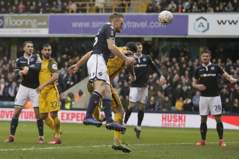 Millwall's Alex Pearce scores a goal during the English FA Cup quarterfinal soccer match between Millwall and Brighton & Hove Albion at The Den in London, Sunday March 17, 2019. (AP Photo/Tim Ireland)
