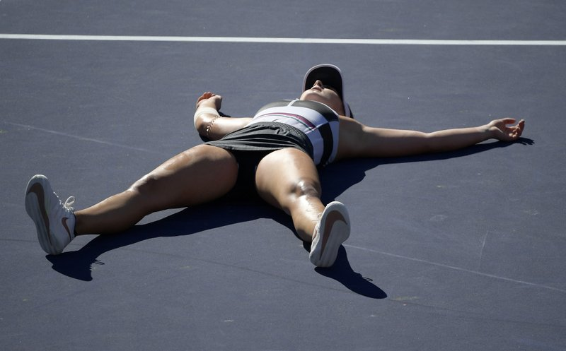 Bianca Andreescu, of Canada, celebrates after defeating Angelique Kerber, of Germany, during the women's final at the BNP Paribas Open tennis tournament Sunday, March 17, 2019, in Indian Wells, Calif. (AP Photo/Mark J. Terrill)