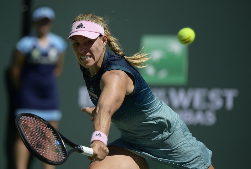Angelique Kerber, of Germany, returns a shot to Bianca Andreescu, of Canada, during the women's final at the BNP Paribas Open tennis tournament Sunday, March 17, 2019, in Indian Wells, Calif. (AP Photo/Mark J. Terrill)