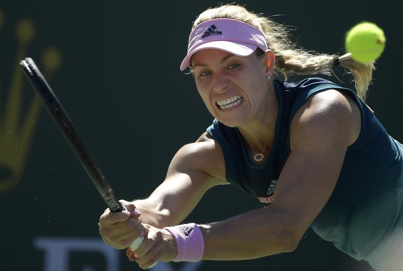 Angelique Kerber, of Germany, returns a shot to Bianca Andreescu, of Canada, at the BNP Paribas Open tennis tournament Sunday, March 17, 2019, in Indian Wells, Calif. (AP Photo/Mark J. Terrill)