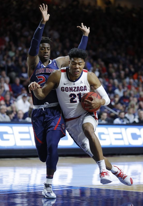 Gonzaga's Rui Hachimura drives into St. Mary's Malik Fitts during the first half of an NCAA college basketball game for the West Coast Conference men's tournament title, Tuesday, March 12, 2019, in Las Vegas. (AP Photo/John Locher)