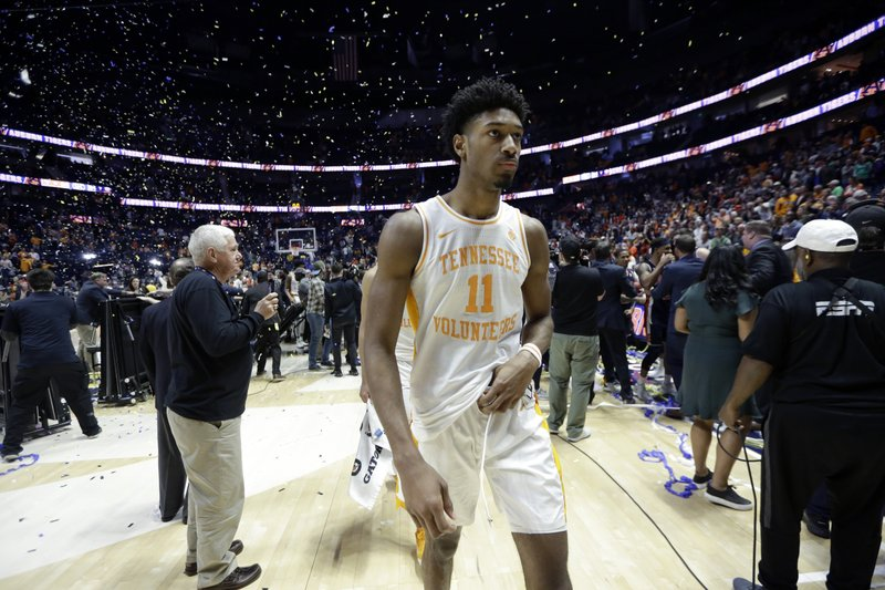 Tennessee's Kyle Alexander walks off the court after losing to Auburn in the championship game of the NCAA Southeastern Conference basketball tournament Sunday, March 17, 2019, in Nashville, Tenn. (AP Photo/Mark Humphrey)