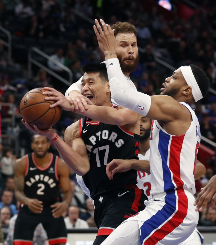 Toronto Raptors guard Jeremy Lin (17) is fouled by Detroit Pistons forward Blake Griffin as guard Bruce Brown, right, defends during the first half of an NBA basketball game, Sunday, March 17, 2019, in Detroit. (AP Photo/Carlos Osorio)