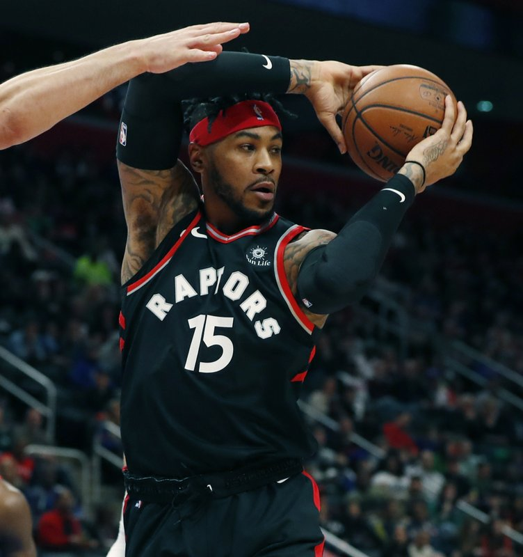 Toronto Raptors forward Eric Moreland looks to pass during the first half of an NBA basketball game against the Detroit Pistons, Sunday, March 17, 2019, in Detroit. (AP Photo/Carlos Osorio)