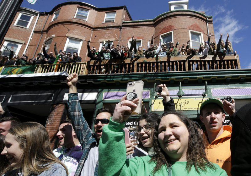 Spectators cheer during the annual St. Patrick's Day parade, Sunday, March 17, 2019, in Boston's South Boston neighborhood. (AP Photo/Steven Senne)