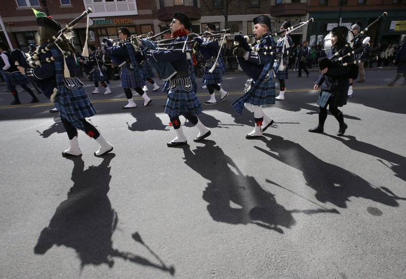 Members of the Berkeley Preparatory School Pipe and Drum Corps, from Tampa, Fla., march during the annual St. (AP Photo/Steven Senne)