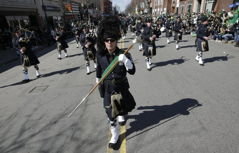 Members of the Boston Police Gaelic Column of Pipes and Drums march during the annual St. Patrick's Day parade, Sunday, March 17, 2019, in Boston's South Boston neighborhood. (AP Photo/Steven Senne)