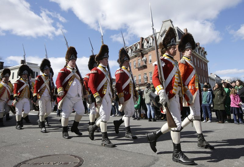 Revolutionary War reenactors in British uniforms march in the annual St. Patrick's Day parade, Sunday, March 17, 2019, in Boston's South Boston neighborhood. (AP Photo/Steven Senne)