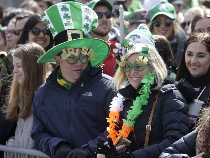 Spectators wear Irish-themed hats and glasses during the annual St. Patrick's Day parade, Sunday, March 17, 2019, in Boston's South Boston neighborhood. (AP Photo/Steven Senne)