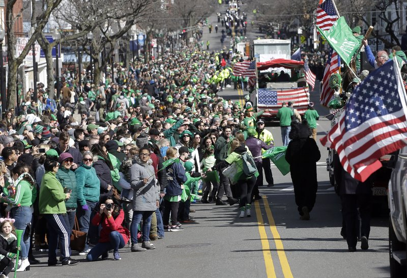 Spectators partially fill a street during a portion of the annual St. Patrick's Day parade, Sunday, March 17, 2019, in Boston's South Boston neighborhood. (AP Photo/Steven Senne)