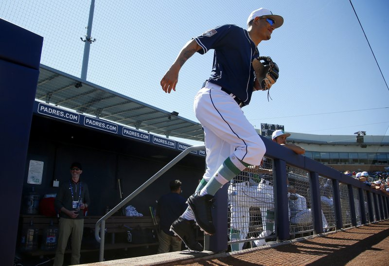 San Diego Padres' Manny Machado runs onto the field for the team's spring training baseball game against the Los Angeles Angels on Sunday, March 17, 2019, in Peoria, Ariz. (AP Photo/Ross D. Franklin)