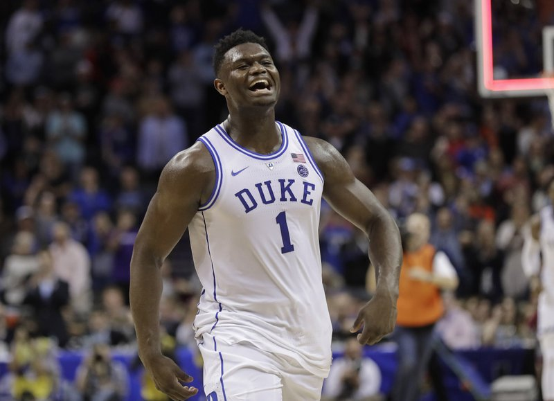 Duke's Zion Williamson (1) celebrates after Duke defeated Florida State in the NCAA college basketball championship game of the Atlantic Coast Conference tournament in Charlotte, N. (AP Photo/Nell Redmond)