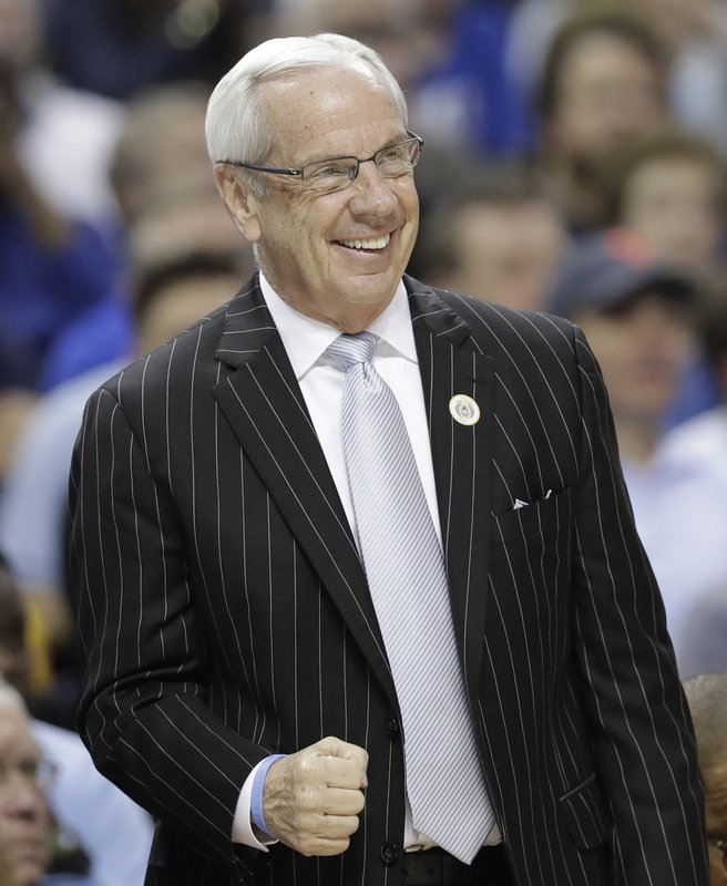 North Carolina head coach Roy Williams pumps his fist after a play against Duke during the first half of an NCAA college basketball game in the Atlantic Coast Conference tournament in Charlotte, N. (AP Photo/Chuck Burton)