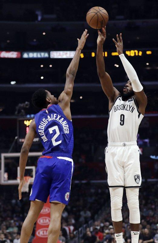 Brooklyn Nets' DeMarre Carroll (9) shoots over Los Angeles Clippers' Shai Gilgeous-Alexander (2) during the first half of an NBA basketball game Sunday, March 17, 2019, in Los Angeles. (AP Photo/Marcio Jose Sanchez)