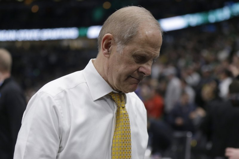 Michigan head coach John Beilein walks off the court after the team's 65-60 loss to Michigan State in an NCAA college basketball championship game in the Big Ten Conference tournament, Sunday, March 17, 2019, in Chicago. (AP Photo/Kiichiro Sato)