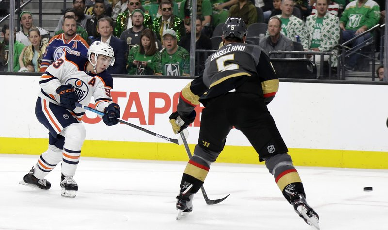 Edmonton Oilers center Ryan Nugent-Hopkins (93) takes a shot against the Vegas Golden Knights during the first period of an NHL hockey game Sunday, March 17, 2019, in Las Vegas. (AP Photo/Isaac Brekken)