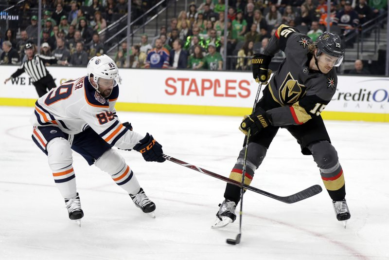 Edmonton Oilers left wing Sam Gagner (89) defends as Vegas Golden Knights right wing Reilly Smith passes the puck during the first period of an NHL hockey game Sunday, March 17, 2019, in Las Vegas. (AP Photo/Isaac Brekken)