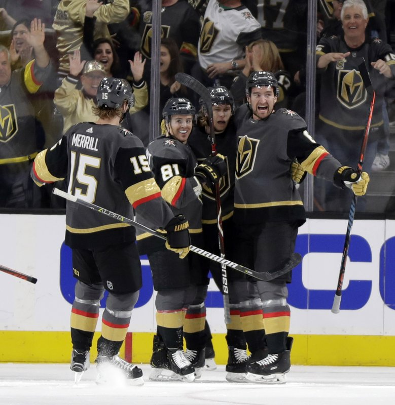 Vegas Golden Knights right wing Mark Stone, right, celebrates with teammates after scoring against the Edmonton Oilers during the first period of an NHL hockey game Sunday, March 17, 2019, in Las Vegas. (AP Photo/Isaac Brekken)