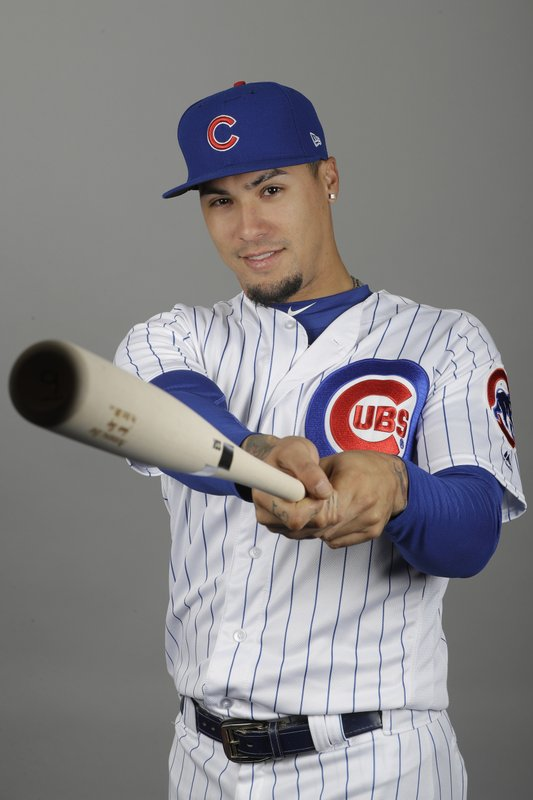 This is a 2019 photo showing Javier Baez of the Chicago Cubs baseball team. It does not take Javier Baez long to show off his magic tricks, even in a spring training game. (AP Photo/Darron Cummings, File)