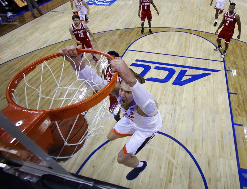 Virginia's Jack Salt (33) dunks against North Carolina State during the first half of an NCAA college basketball game in the Atlantic Coast Conference tournament in Charlotte, N. (AP Photo/Chuck Burton)