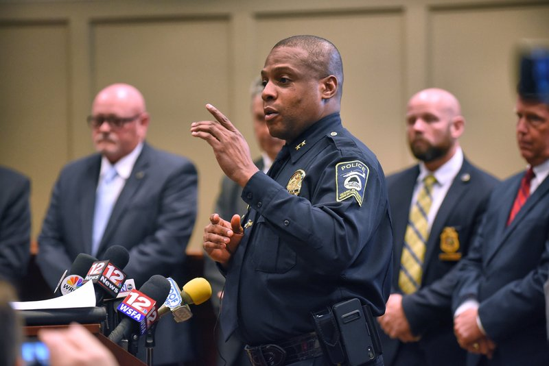 Ozark (Ala.) Police Chief Marlos Walker comments during a press conference Monday, March 18, 2019 announcing the arrest of Coley McCraney of nearby Dothan for the 1999 slayings of Dothan teens J. (Jay Hare/Dothan Eagle via AP)