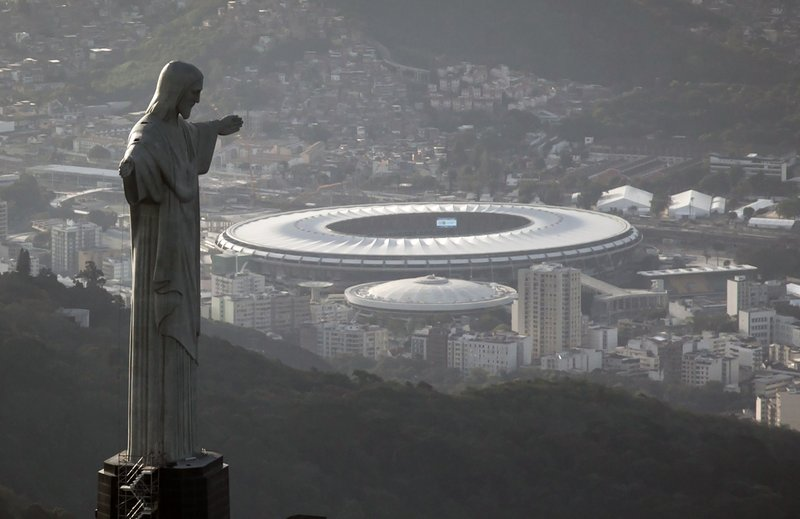 FILE - This May 13, 2014, file photo, the Maracana stadium behind the Christ the Redeemer statue, in Rio de Janeiro, Brazil. (AP Photo/Felipe Dana, File)