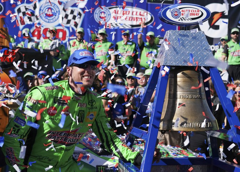 Kyle Busch celebrates after winning a NASCAR Cup Series auto race at Auto Club Speedway, in Fontana, Calif. (AP Photo/Rachel Luna)