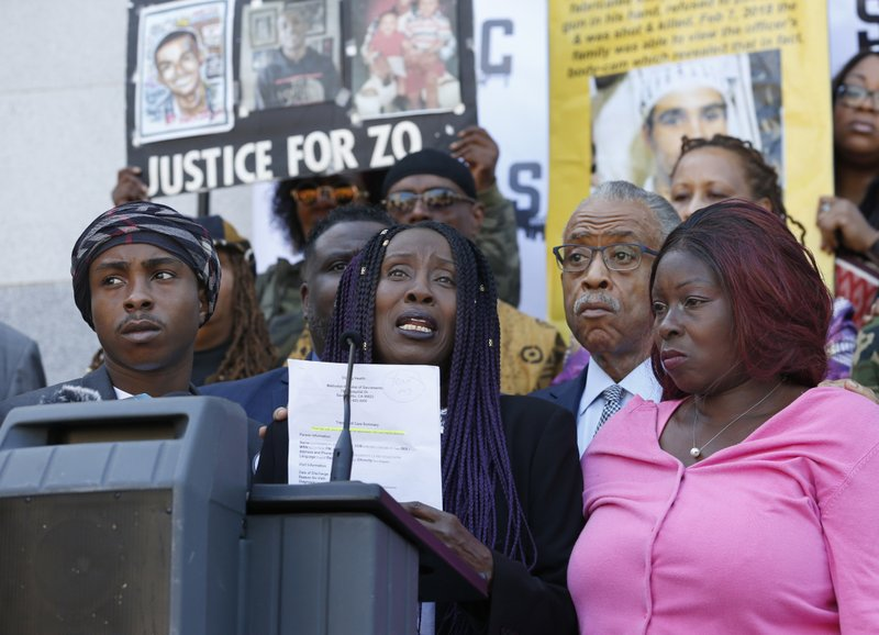 Sequitta Thompson, second from left, the grandmother of police shooting victim Stephon Clark, calls for justice for her grandson during a news conference at the Capitol on Monday, March 18, 2019, in Sacramento, Calif. (AP Photo/Rich Pedroncelli)