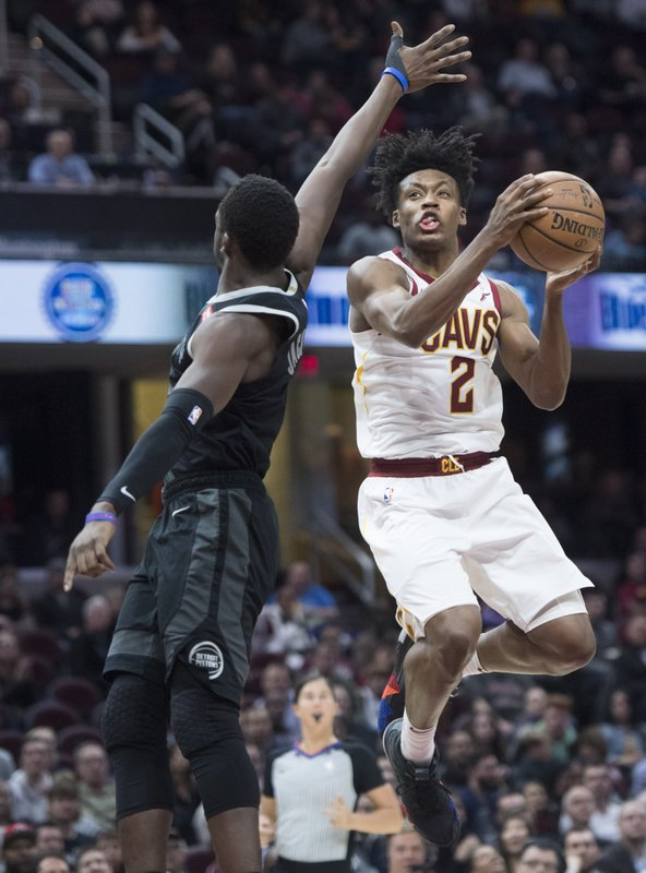 Cleveland Cavaliers' guard Collin Sexton drives to the basket against Detroit Pistons' guard Reggie Jackson, from Italy, in the first half of an NBA basketball game, Monday, March 18, 2019, in Cleveland. (AP Photo/Ken Blaze)
