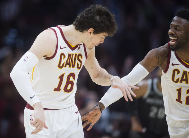 Cleveland Cavaliers' forward Cedi Osman, from Turkey, celebrates with guard David Nwaba after hitting a three-point basket in the second half of an NBA basketball game, Monday, March 18, 2019, in Cleveland. (AP Photo/Ken Blaze)