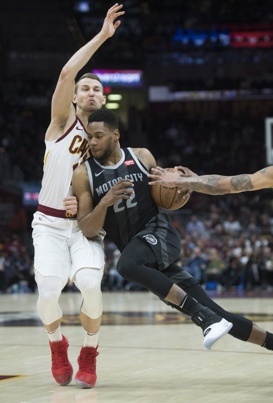 Detroit Pistons' guard Glenn Robinson III, right, drives to the basket against Cleveland Cavaliers' guard Nik Stauskas in the second half of an NBA basketball game, Monday, March 18, 2019, in Cleveland. (AP Photo/Ken Blaze)