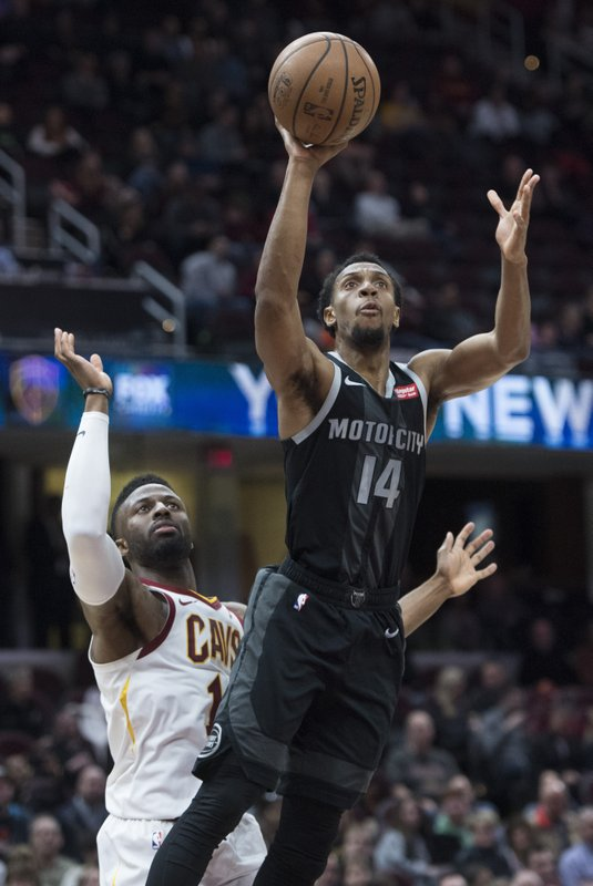 Detroit Pistons guard Ish Smith (14) shoots as Cleveland Cavaliers guard David Nwaba defends in the second half of an NBA basketball game, Monday, March 18, 2019, in Cleveland. (AP Photo/Ken Blaze)