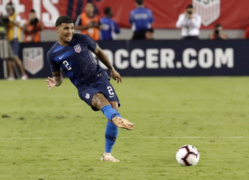 FILE - In this Oct. 11, 2018, file photo, United States' DeAndre Yedlin (2) moves the ball against Colombia during the second half of an international friendly soccer match in Tampa, Fla. (AP Photo/John Raoux, File)