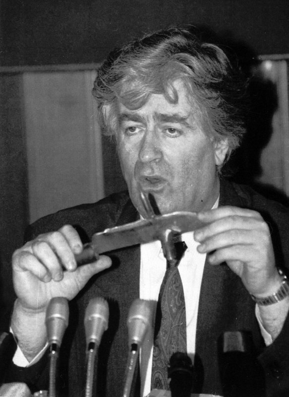 FILE - In this Sept. 23, 1992 file photo, Bosnian Serb leader Radovan Karadzic holds a knife he said was seized from Bosnian Croat soldiers in Bosnia during a news conference in Belgrade, Yugoslavia. (AP Photo/File)