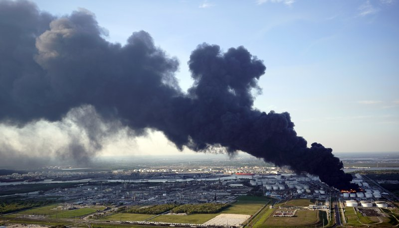 A plume of smoke rises from a petrochemical fire at the Intercontinental Terminals Company Monday, March 18, 2019, in Deer Park, Texas. (AP Photo/David J. Phillip)