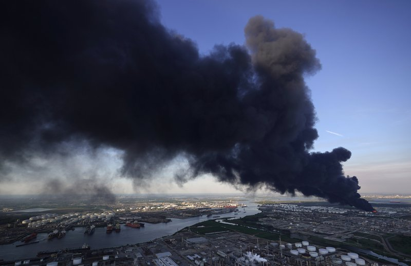 A plume of smoke rises from a petrochemical fire at the Intercontinental Terminals Company, Monday, March 18, 2019, in Deer Park, Texas. (AP Photo/David J. Phillip)