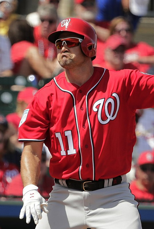 Washington Nationals' Ryan Zimmerman (11) reacts at bat during an exhibition spring training baseball game against the St. (AP Photo/Brynn Anderson)
