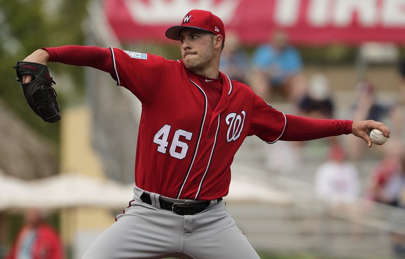 Washington Nationals starting pitcher Patrick Corbin (46) delivers in the first inning of an exhibition spring training baseball game against the St. (AP Photo/Brynn Anderson)