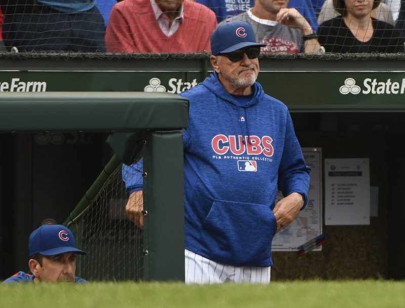 FILE - In this Oct. 1, 2018, file photo, Chicago Cubs manager Joe Maddon (70) looks on after Milwaukee Brewers' Domingo Santana (16) scores during the eighth inning of a tie break baseball game against the Chicago Cubs in Chicago. (AP Photo/Matt Marton, File)