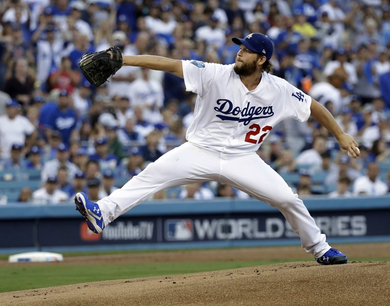 FILE - In this Oct. 28, 2018, file photo, Los Angeles Dodgers pitcher Clayton Kershaw winds up during the first inning in Game 5 of the World Series baseball game against the Boston Red Sox, in Los Angeles. (AP Photo/David J. Phillip, File)