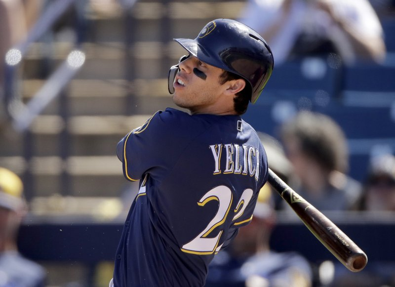 FILE - In this Sunday, March 3, 2019, file photo, Milwaukee Brewers' Christian Yelich watches his RBI-double during the second inning of a spring training baseball game against the Cincinnati Reds in Phoenix. (AP Photo/Charlie Riedel, File)
