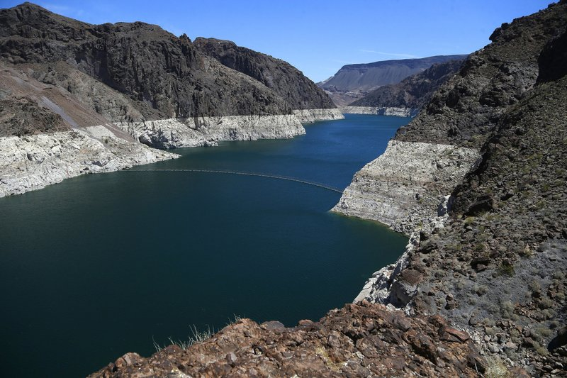 FILE - This May 31, 2018 file photo shows the reduced water level of Lake Mead behind Hoover Dam in Arizona. (AP Photo/Ross D. Franklin, File)